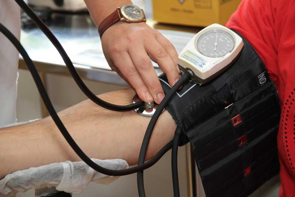 Doctor measuring patients blood pressure with arm band